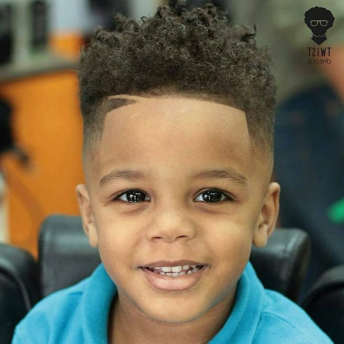little black boy haircuts, black curly hair, large brown eyes, blue shirt