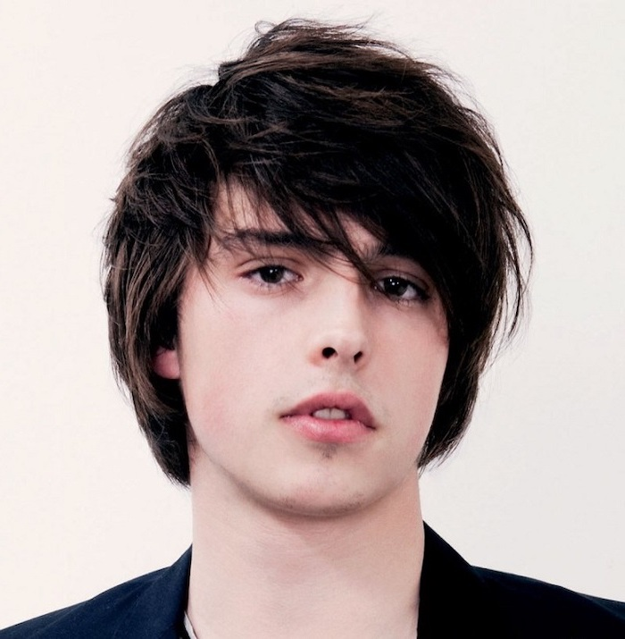 black straight hair, black blazer, white background, trendy haircuts for men