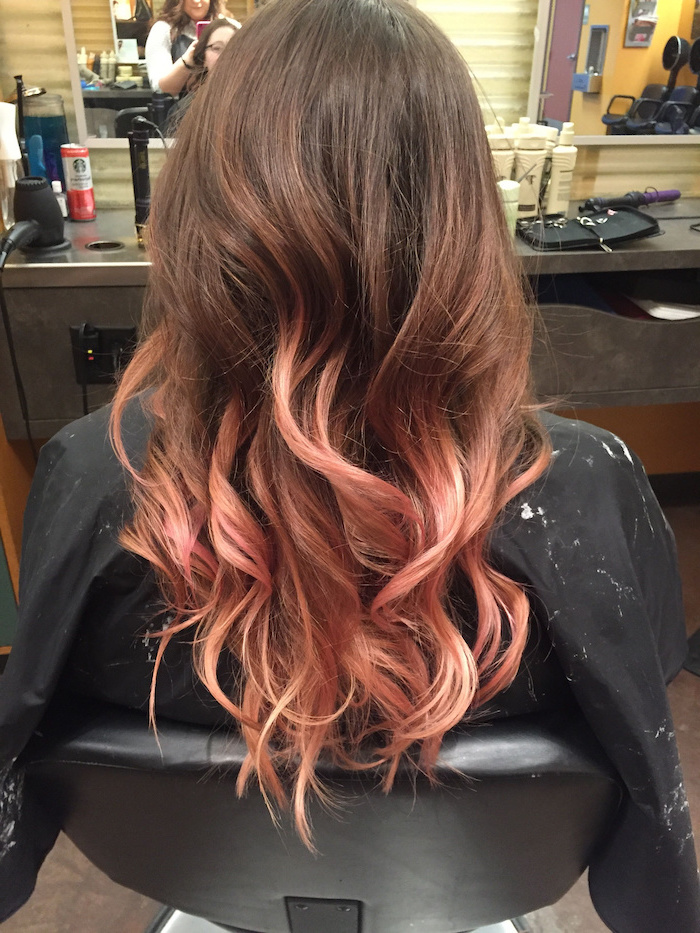 ombre hair brown to blonde, brown to rose gold, long wavy hair, black leather chair