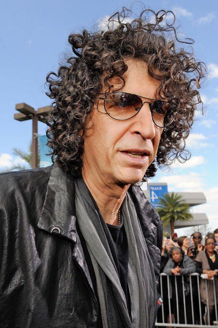 wavy hair men, howard stern, wearing sunglasses, black curly hair, black leather jacket