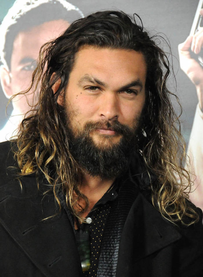 jason momoa, black curly hair, blonde highlights, wavy hair men, black blazer, long beard