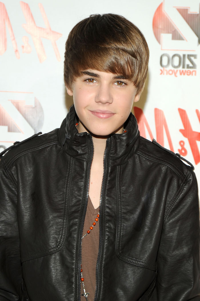 justin bieber, iconic haircut, side sweep, black leather jacket, brown t shirt, cool haircuts for boys