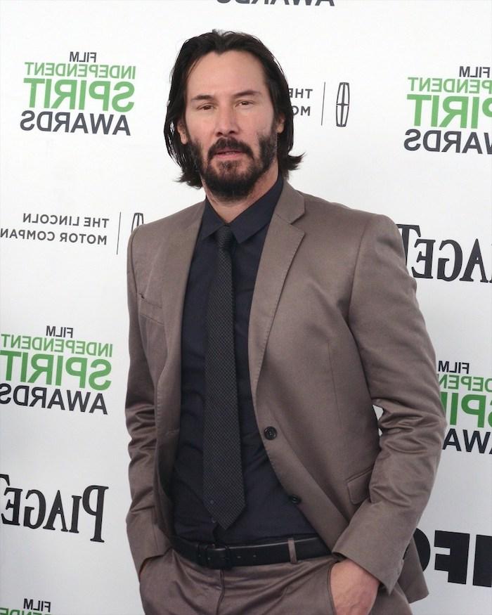 keanu reeves, hairstyle for men, grey suit, black shirt, black tie, black hair