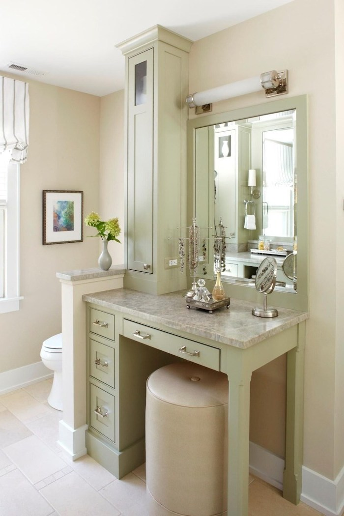 light green wooden table, with drawers, granite countertop, makeup desk vanity, beige leather ottoman