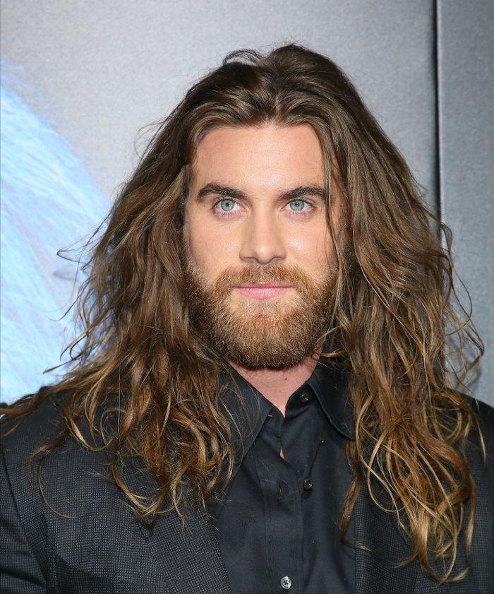 dark blonde, curly hair, haircuts for men with thick hair, black blazer, black shirt, blue eyes