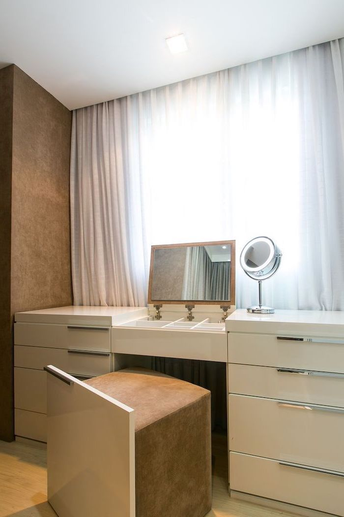 white curtains, white table, pull out mirror, pull out ottoman, mirrored vanity table