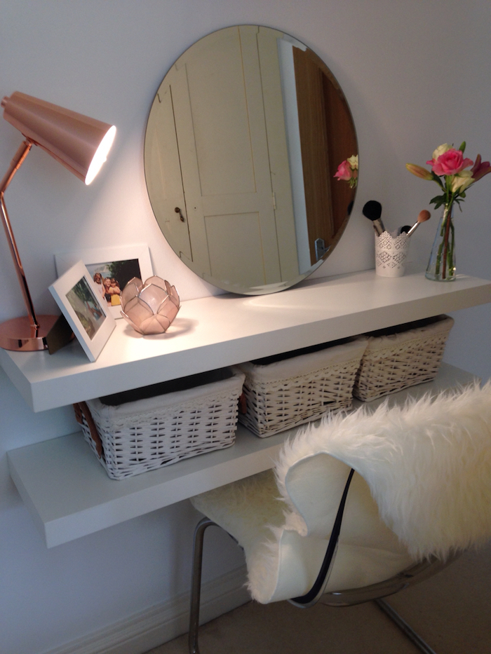 round mirror, floating shelves with baskets, makeup vanity chair, white furry cover