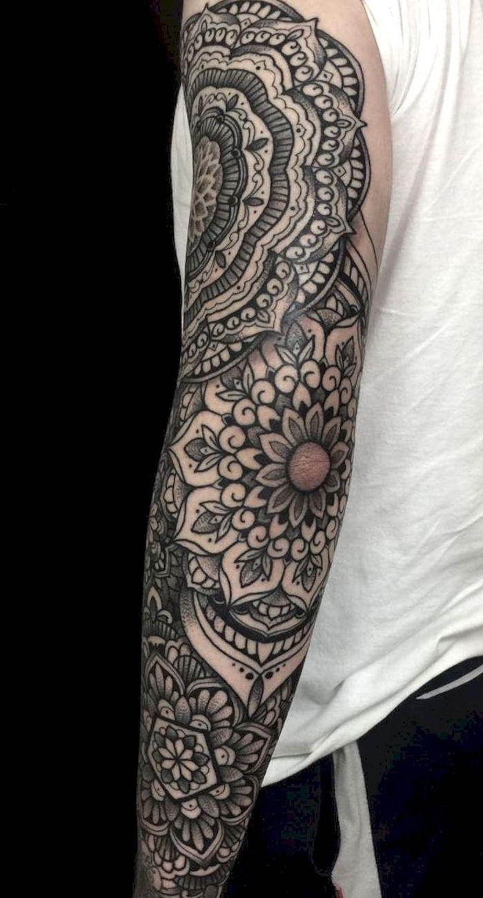 floral mandala, white top, black background, skull sleeve tattoo
