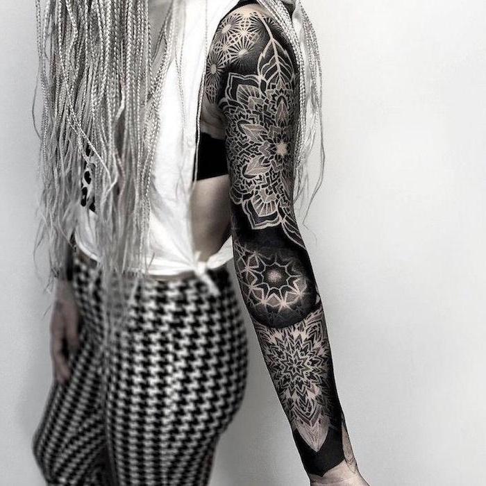 mandala tattoo, skull sleeve tattoo, white top, black and white pant, white background