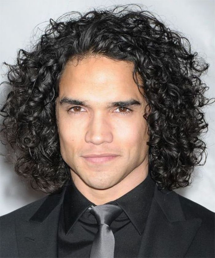 black curly hair, black blazer, black shirt, black satin tie, hairstyles for men with long hair