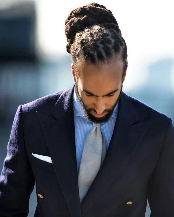 dark blue blazer, grey tie, blue shirt, hairstyles for men with long hair, dreadlocks in a bun