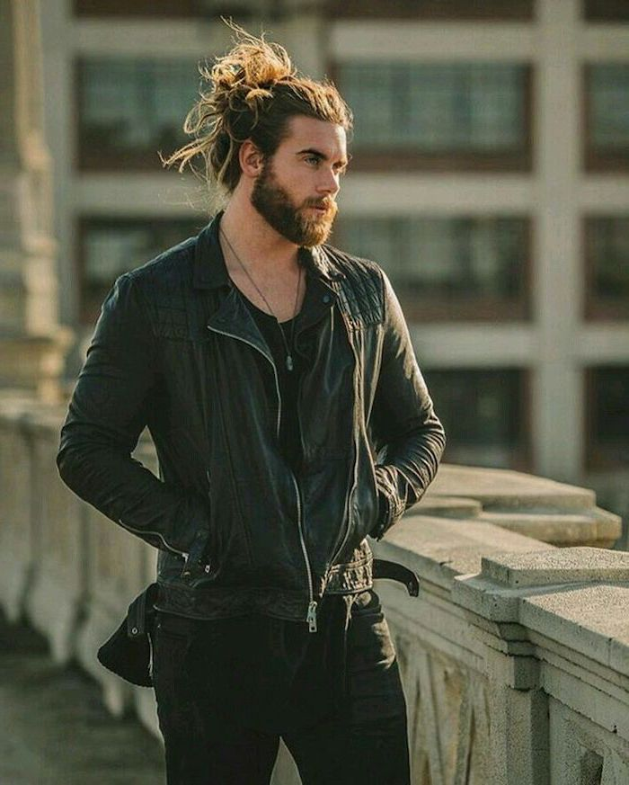 brown hair, in a bun, medium length hair men, black leather jacket, black jeans, black shirt