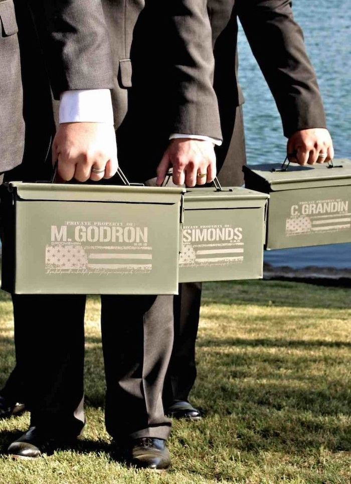 three men, wearing black suits, good groomsmen gifts, metal ammo boxes, personalised with names, usa flag
