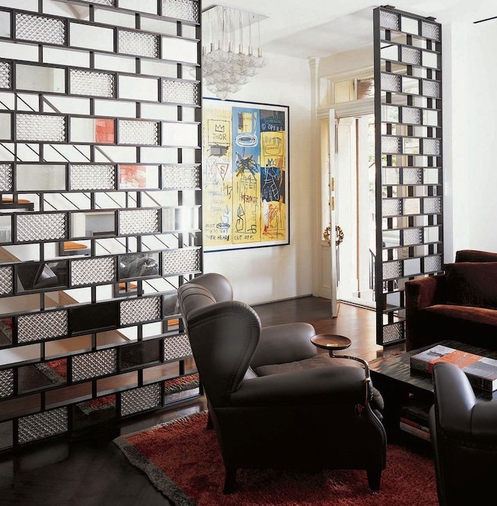 glass blocks, black metal frame, panel room divider, black leather armchair, brown velvet sofa