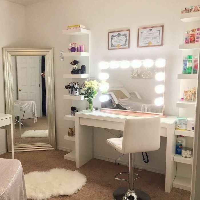 white leather stool, mirror with lights, makeup vanity chair, white table and shelves, lots of products