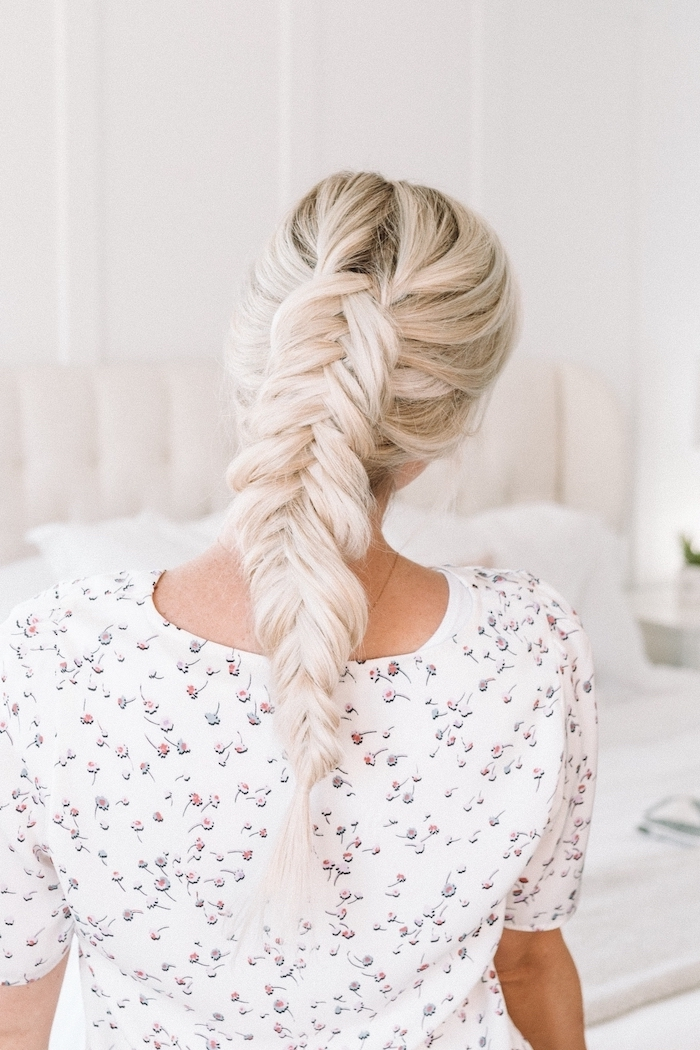 blonde hair, fishtail braided ponytail, floral top, how to braid, white background