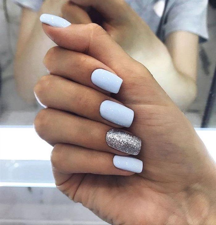 blue glitter, silver glitter, nail polish, coffin nail ideas, short nails, blurred background