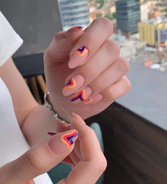 summer acrylic nails, nude nail polish, yellow and red, purple lines, silver bracelet