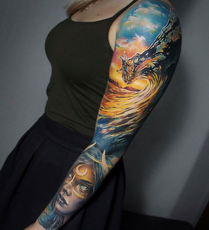 ocean waves, female face, forearm sleeve tattoo, watercolour tattoo, olive green top, grey background