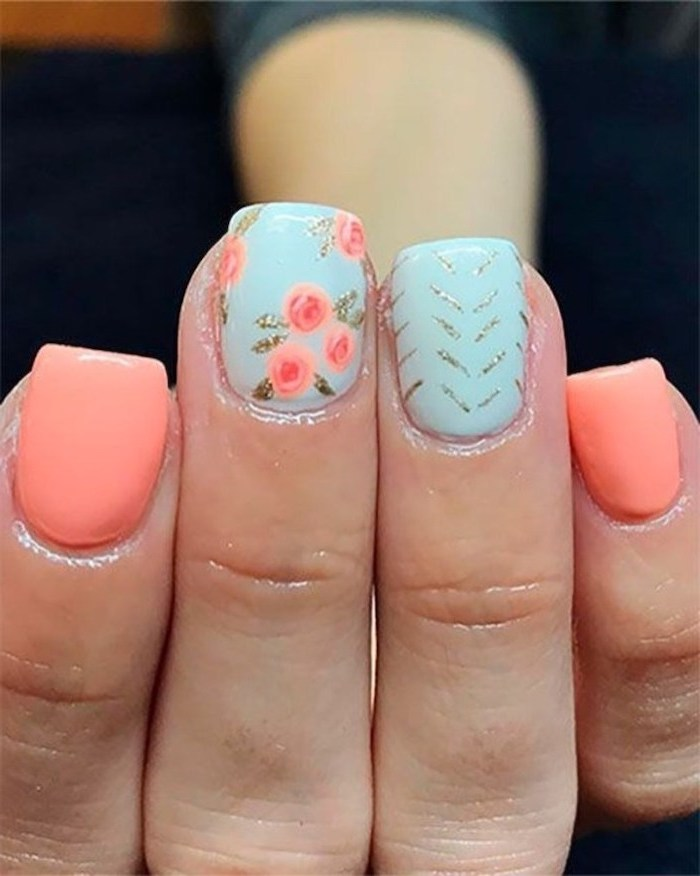 pink and blue nail polish, pink flowers, silver glitter, summer acrylic nails, blurred background