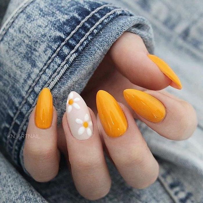 denim jacket, orange nail polish, white daisies, nail color ideas