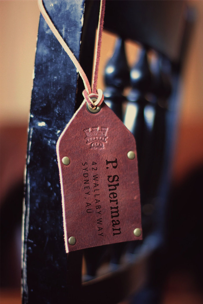brown leather, luggage tag, groomsmen proposal, personalised with name, black chair