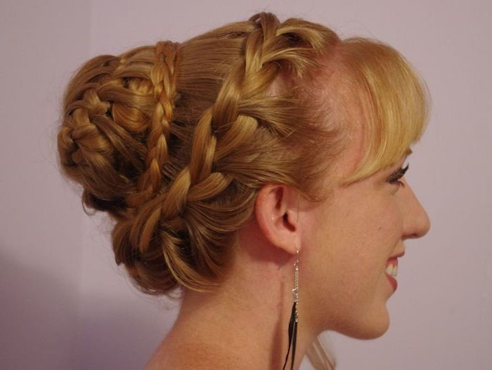blonde hair, intricate braided updo, natural hairstyles braids, pink background