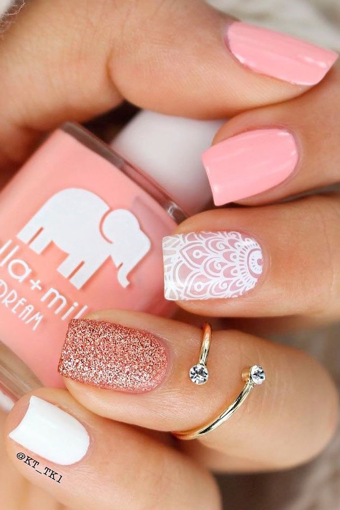 pink white and glitter nail polish, gold ring, nail design ideas, nail polish bottle