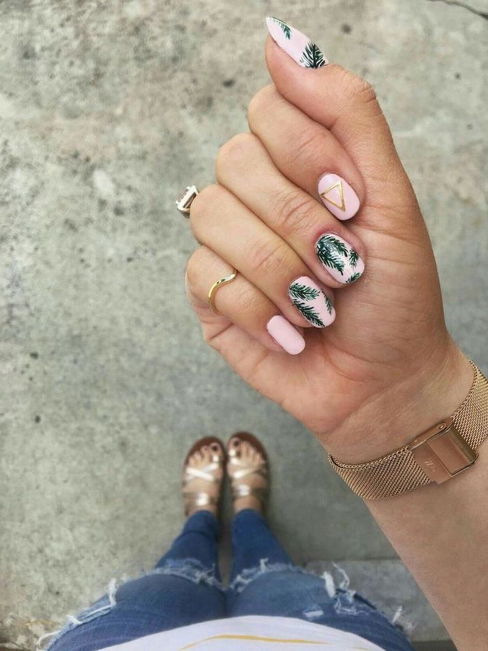 pink nail polish, green leaves, golden triangle, gold watch, blurred background, nail design ideas