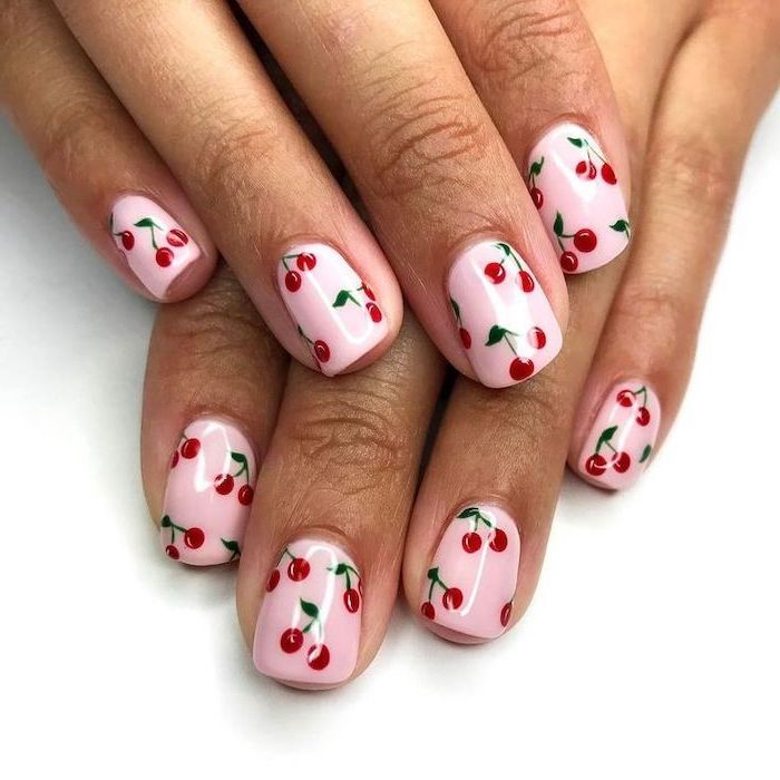 nail designs for short nails, pink nail polish, red cherries, white background