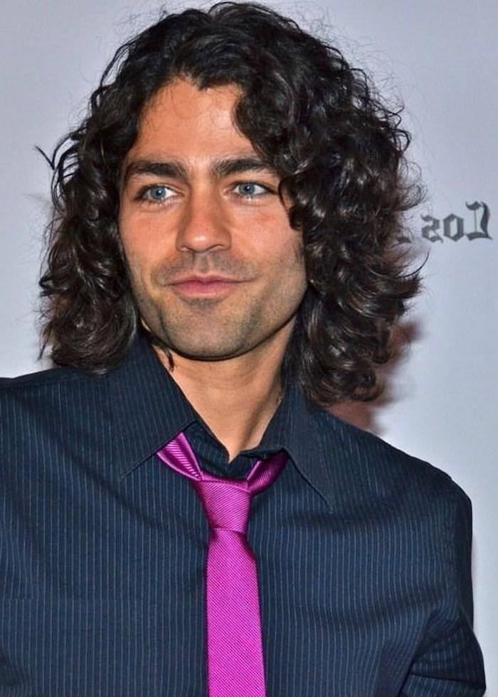 black curly hair, black shirt, pink tie, medium length hair men, adrian grenier, blue eyes