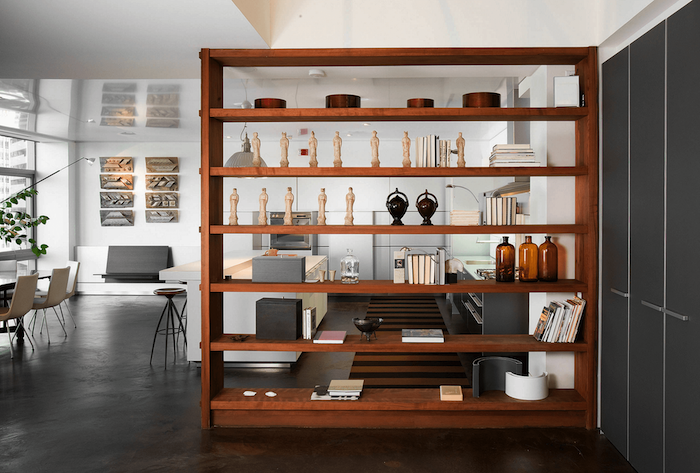 wooden bookshelf, folding room dividers, white chairs, kitchen island, metal bar stools