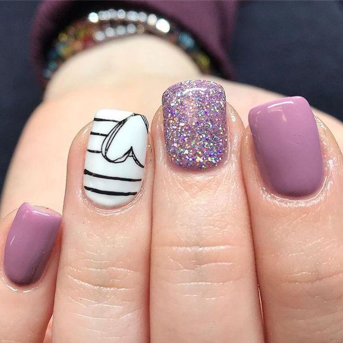 purple and white nail polish, black heart, purple glitter, nail designs for short nails