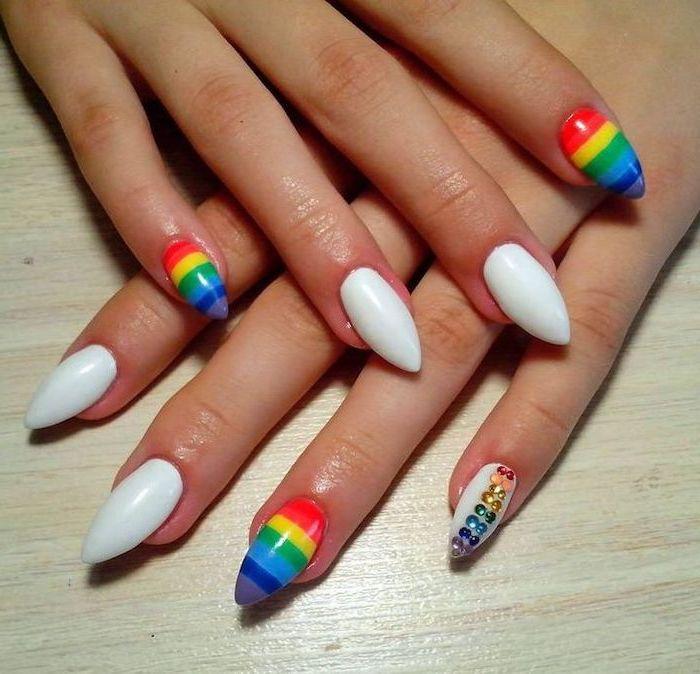 white nail polish, rainbow colored nails, cute short nails, wooden table