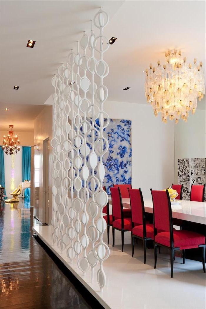 white round blocks, folding room dividers, red chairs, dining room, hanging large chandelier