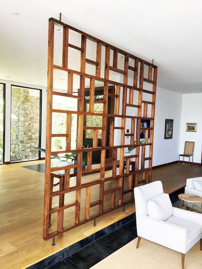 folding room dividers, made of wood, white armchairs, wooden floor, tall windows, white walls