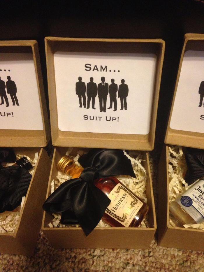 carton box, suit up, bottle of henessy, with black satin bow, groomsmen proposal