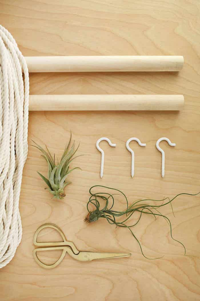 step by step, diy tutorial, wooden poles, white rope, metal hooks, wooden background, room separator