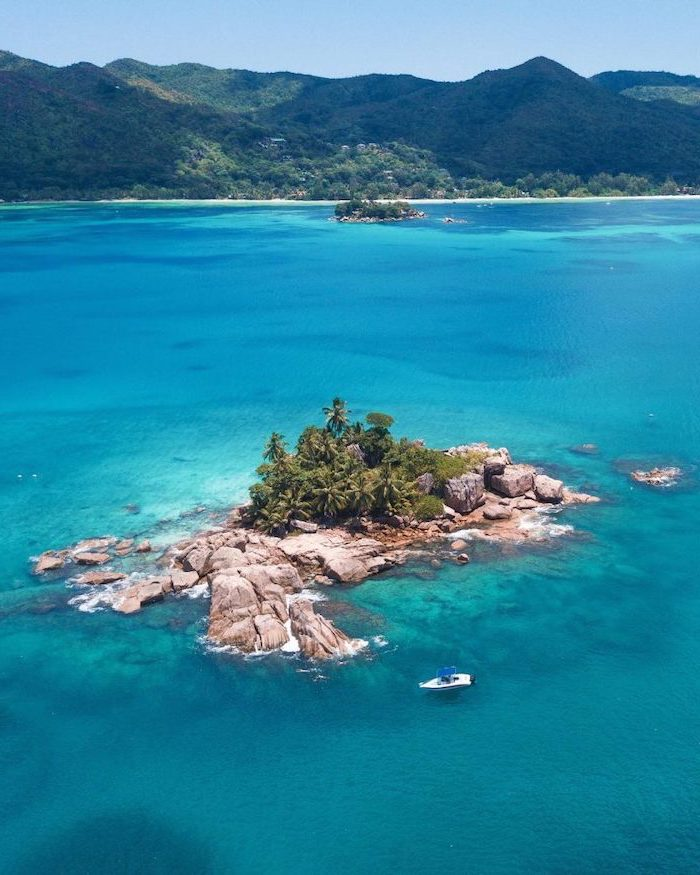 seychelles islands, blue ocean water, small boat, photographed from above