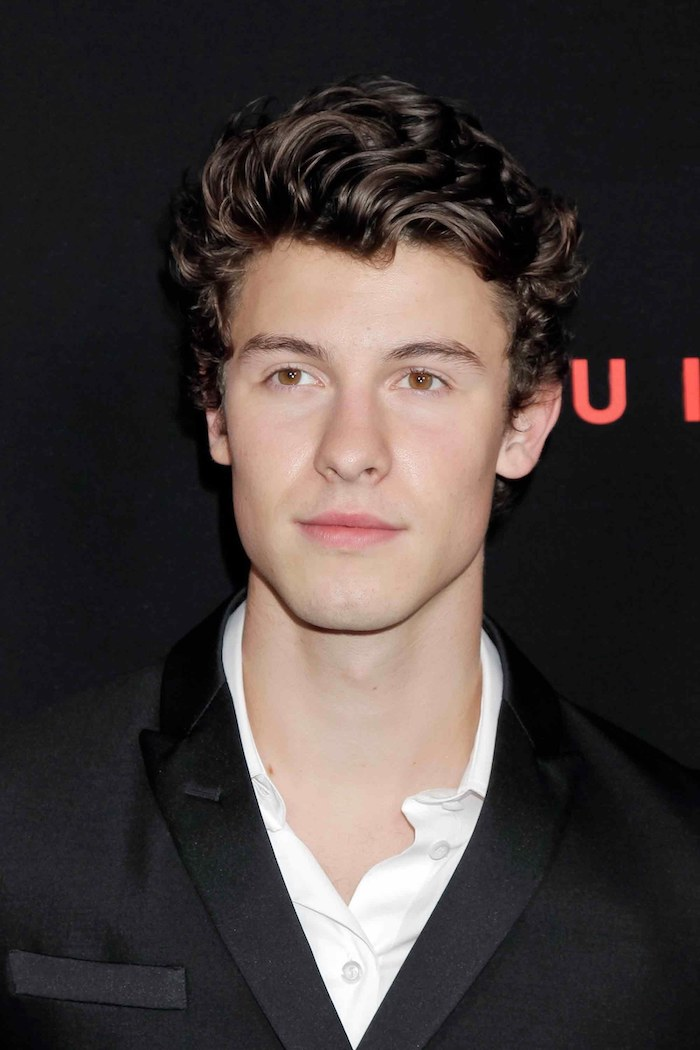 shawn mendes, brown curly hair, cool guy haircuts, black blazer, white shirt