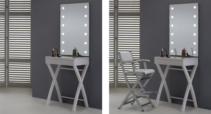 lighted mirror, side by side photos, white makeup vanity, grey wall, tall white leather stool