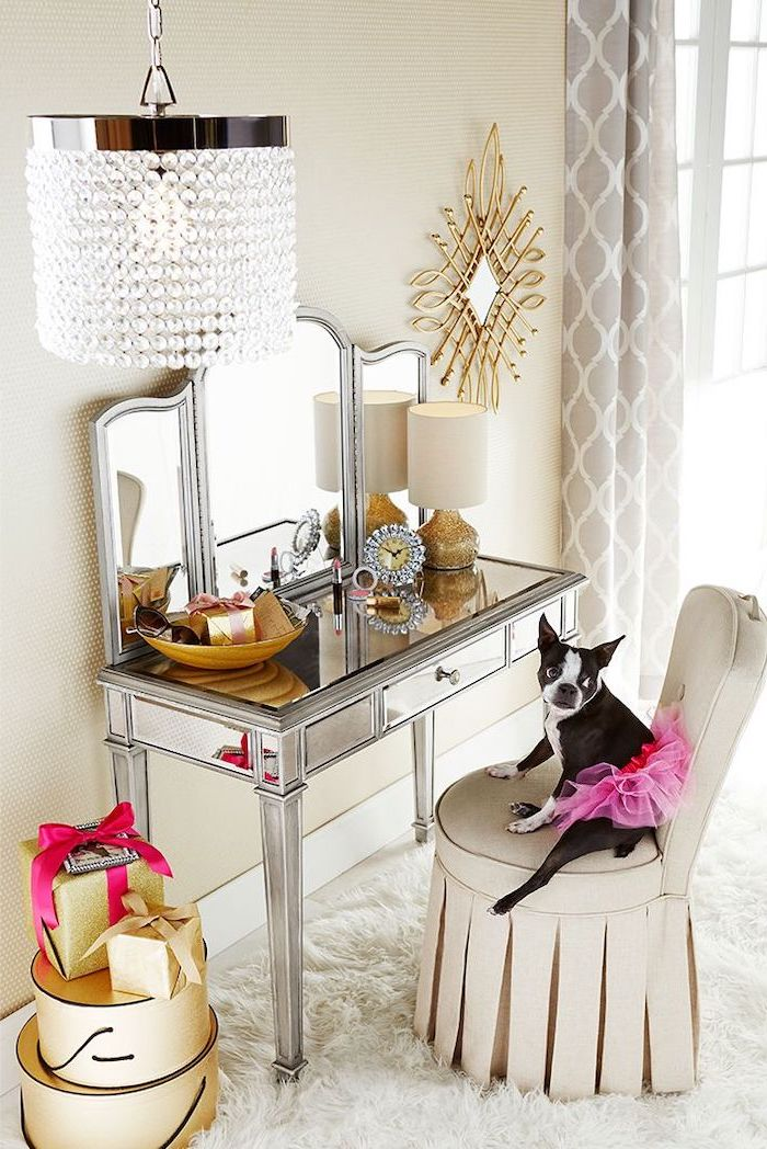 mirrored table, white chair, dog sitting on it, corner makeup vanity, three fold mirror