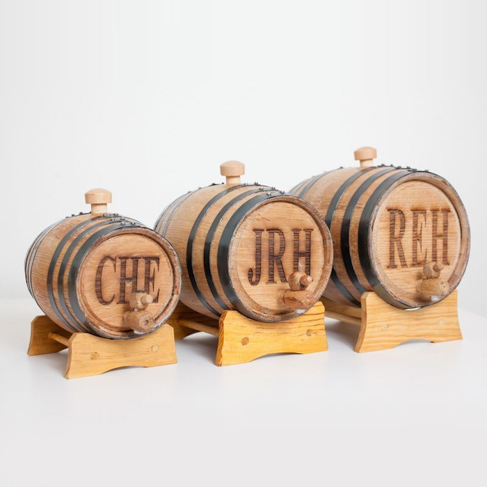 small wooden, whiskey barrels, personalised with initials, groomsmen watches, white background