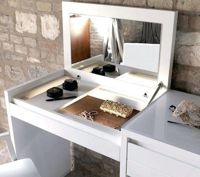 corner makeup vanity, white table, pull out mirror, white chair, stone wall