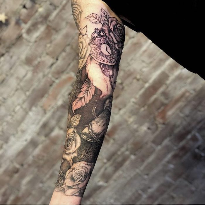 brick wall, religious tattoo sleeve, flowers and stopwatch, black top