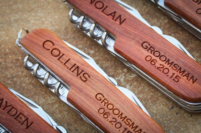 wooden swiss knives, personalised with names and dates, groomsmen watches, brown background