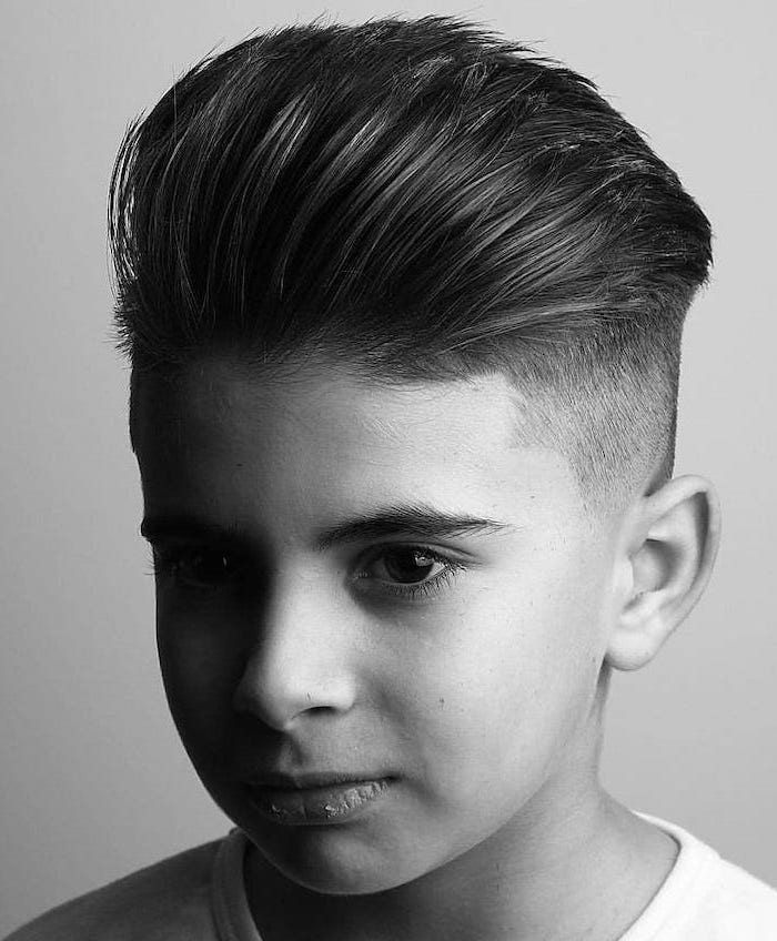 cool hairstyles for men, black and white photo, long top, white shirt