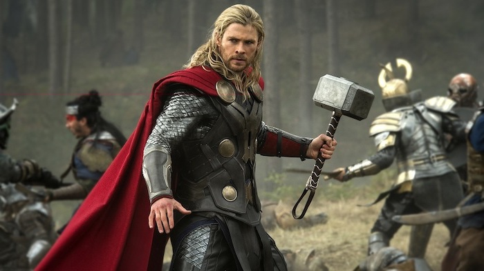 chris hemsworth as thor, holding a hammer, medium length hair men, blonde hair