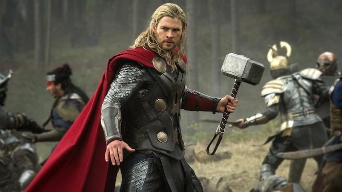 chris hemsworth as thor, holding a hammer, medium length hair men, blonde hair