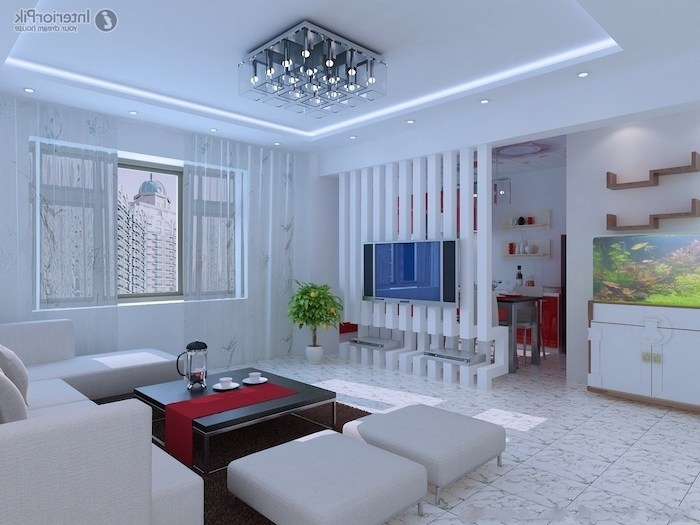 bookshelf room divider, white corner sofa, white ottomans, tiled floor, white poles, black coffee table